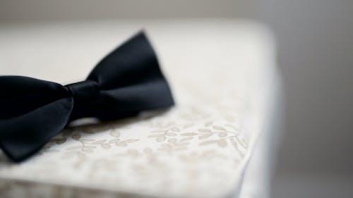 Black Bowtie on Table. Fashion Background.