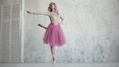 Ballet Dancer in a Pink Tutu and Pointe Shoes. Beautiful Young Ballerina at a Rehearsal. Lightness