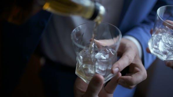 Thumbnail for Elegant Businessman Pouring Whiskey Into Glass