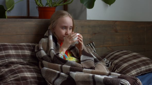 Thumbnail for Little Girl Caught Flu and Drinking Hot Tea in Bed