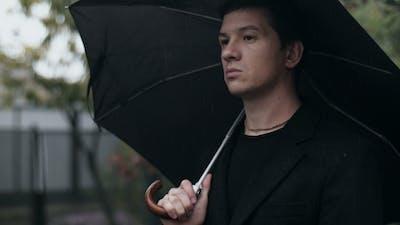Sad Man with Umbrella
