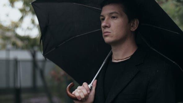 Thumbnail for Sad Man with Umbrella