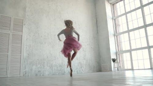 Ballerina Performing Pirouettes in Studio