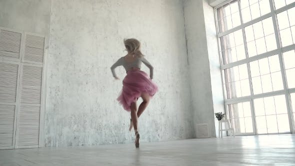 Ballerina Performing Pirouettes in Studio