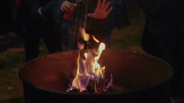Thumbnail for People Warm Hands Next To Fire on Street