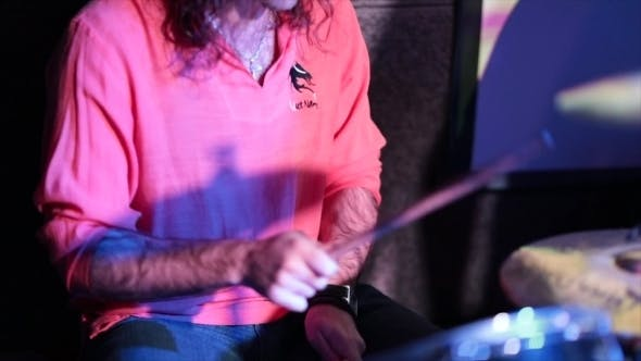 Cover Image for Musician Playing Drums on Stage