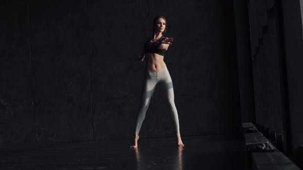Cover Image for Flexible Girl Is Warming Up. Young Woman in Sportswear Doing Yoga