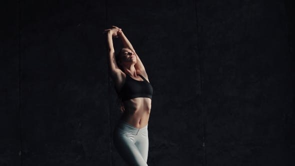 Thumbnail for Young Attractive Girl Gymnast Warming Up Before a Workout