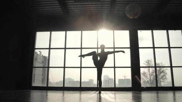 Thumbnail for Silhouette of a Gymnast on the Background of a Large Window