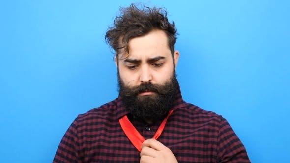 Thumbnail for Bearded Man Tries to Tie a Tie and Can Not Do It