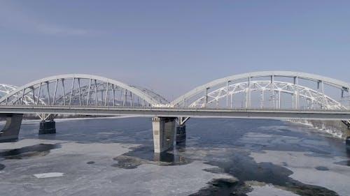Aerial View of the Kiev City, Ukraine. Dnieper River with Bridges. Darnitskiy Bridge