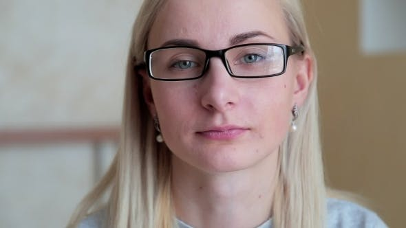 Thumbnail for Blonde Woman Smiling with Glasses