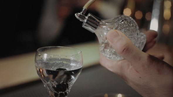 Thumbnail for Bartender Adds Fragrance To Dry Martini Cocktail