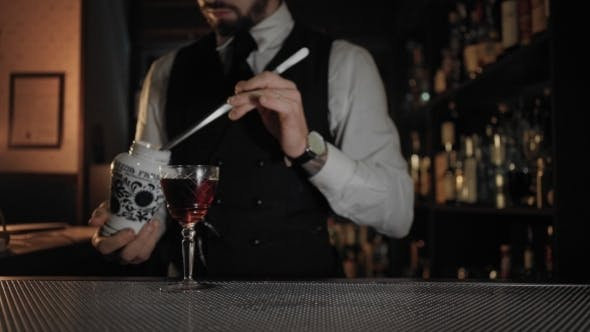 Thumbnail for Professional Barman at Dark Lit Bar Prepares Drink