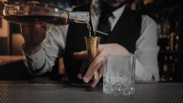 Thumbnail for Bartender Shows His Art of Mixind Drinks