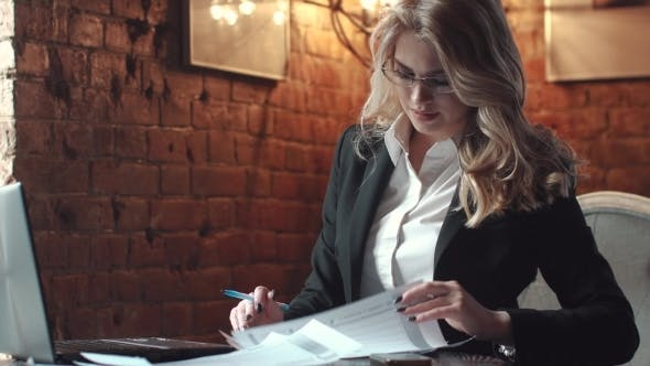 Thumbnail for Business Woman Working with Documents in the Office