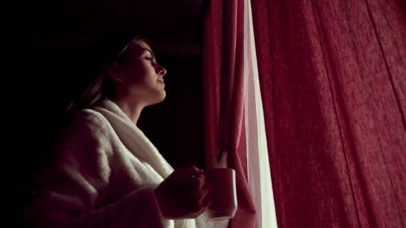 Thumbnail for Woman Having Coffee Near Curtains