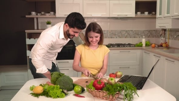 Thumbnail for Happy Couple Cook with Laptop