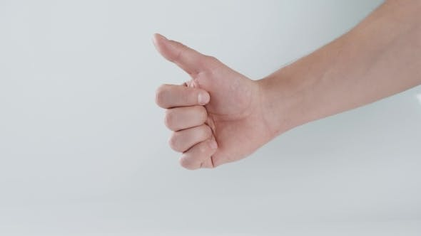 Thumbnail for Male Hand Showing Thumbs Up Sign Against White Background