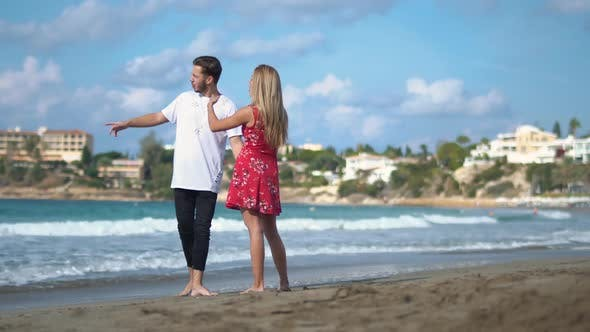 Thumbnail for Young Couple Standing at the Rocky Sea Cost Talking Emotionally, Man and Woman Arguing, Man Makes