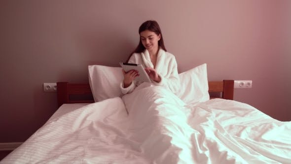 Thumbnail for Woman in Bed with Tablet