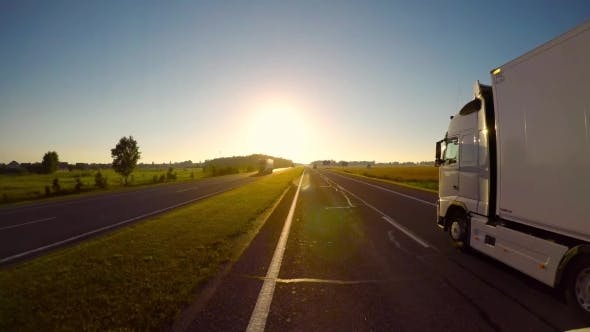 Thumbnail for Car Driving on the Autobahn at Sunrise
