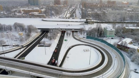 Thumbnail for Aerial View of a Freeway Intersection Snow-covered in Winter