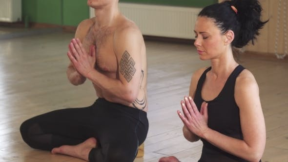 Thumbnail for Beautiful Couple Meditating Together Doing Yoga
