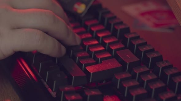 Thumbnail for Cyber Crime, the Hands of a Man Who Is Gaining Something on the Keys