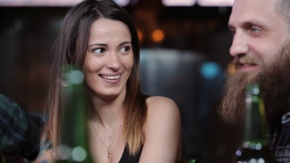Thumbnail for Friends Laugh, Drink Beer and Cocktails While Having a Good Time Together at a Bar
