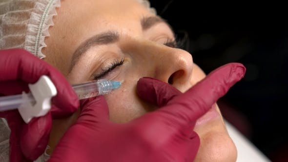 Cover Image for Young Woman Having a Under Eye Filler Injections