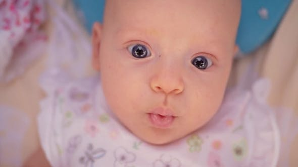 Thumbnail for Cute Three Months Baby Girl with Big Blue Eyes