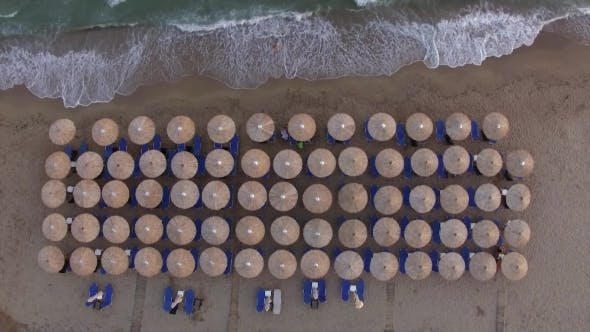 Thumbnail for Sunbeds at the Beach with Few People Relaxing There, Aerial View
