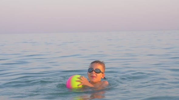 Thumbnail for Happy Child Bathing in the Sea with Ball