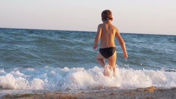 Thumbnail for Child Enjoying Vacation on the Coast and Running Into Sea To Swim