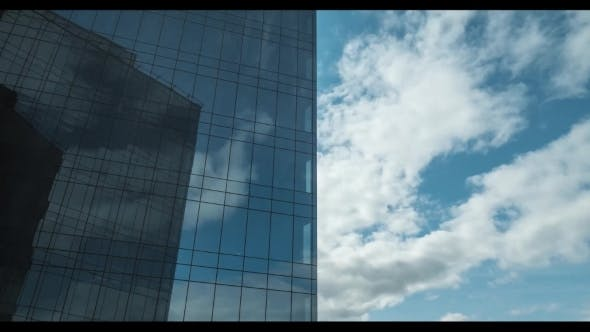 Clouds Moving and Reflecting in Glassy Skyscraper