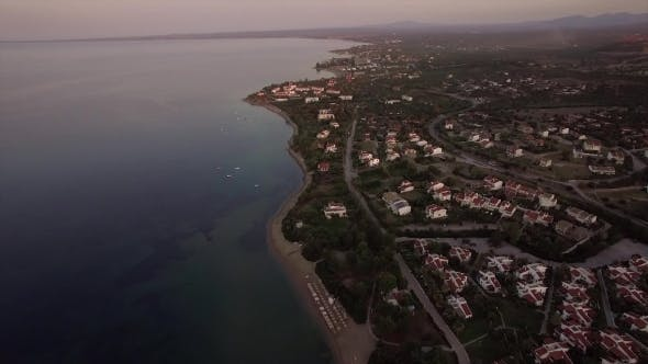 Thumbnail for Aerial Shot of Cottages Along the Shoreline. Trikorfo Beach, Greece