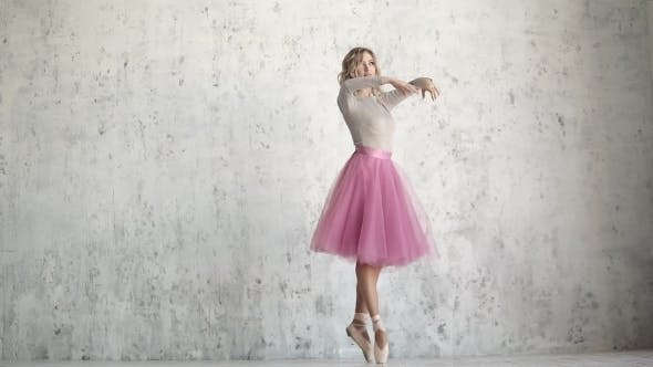 Thumbnail for Ballerina in the Pointe Is Spinning on Tiptoe. Ballet Dancer in a Classical Pack on a Background of