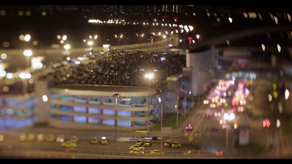 Night Shot of Car Traffic Near Parking Lot