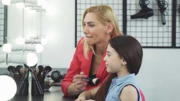 Thumbnail for Happy Beautiful Woman Applying Makeup on Her Cute Daughter