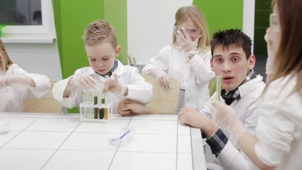 Thumbnail for Teacher and Schoolboy Make Experiments in the Chemistry Class