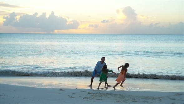 Thumbnail for Family of Father and Little Adorable Girls Enjoying Beach Vacation in the Evening