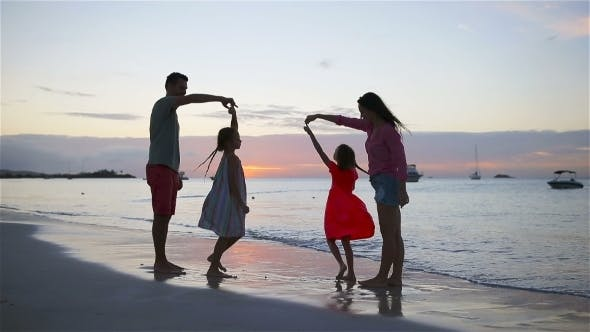 Thumbnail for Happy Beautiful Family on White Beach Having Fun in the Evening