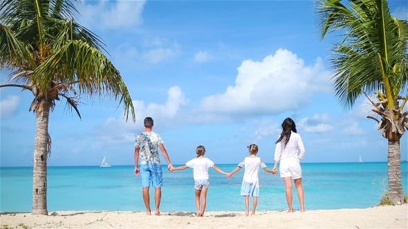 Thumbnail for Family of Four on the Beach on Caribbean Vacation
