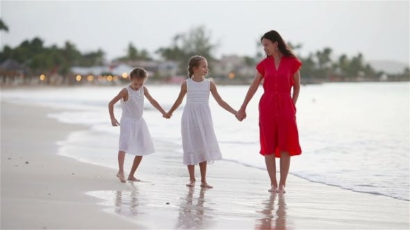 Thumbnail for Beautiful Mother and Daughters on Caribbean Beach Walking on Tropical Seashore
