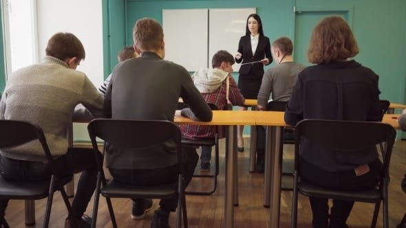 Thumbnail for Woman Teacher Talking To Students During a Lesson at University