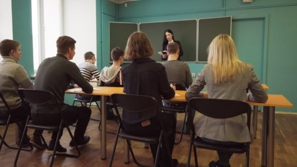 Thumbnail for Woman Lecturer Speaks To Students in Classroom