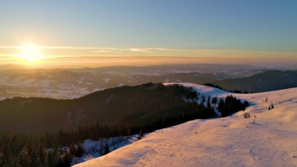 Thumbnail for Flying Over Winterland, Mountain Snow Covered Winter Landscape.
