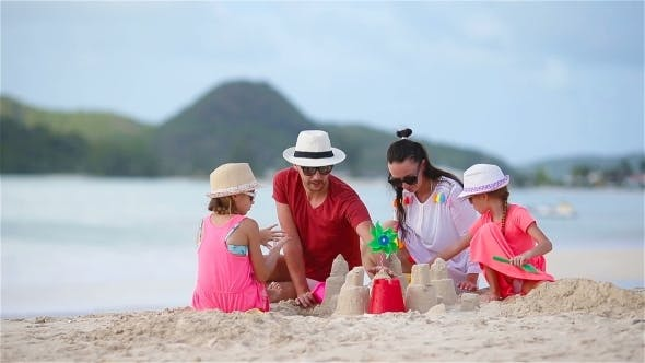 Thumbnail for Family Making Sand Castle at Tropical White Beach