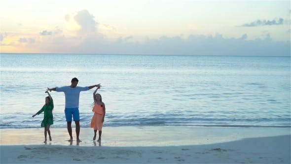 Thumbnail for Family of Dad and Kids Enjoying Beach Vacation